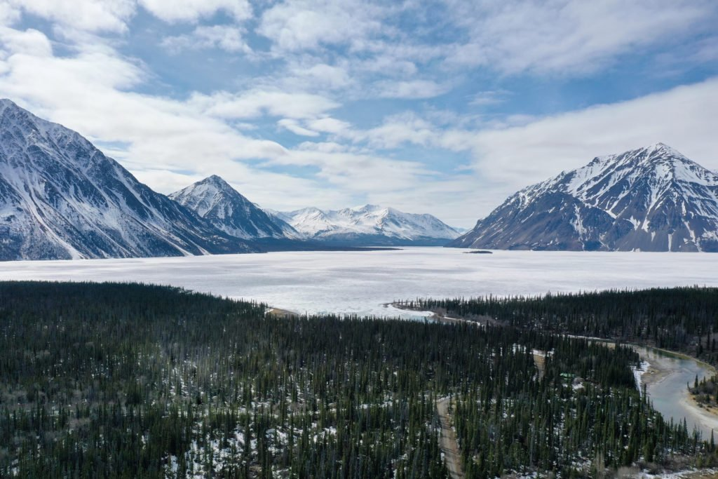 An aerial view of the Kathleen Lake, one of the best ice fishing destinations in Canada. Kathleen river in the right down corner of the image. Mountains and forest also seen on the image