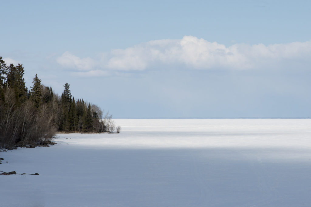 A view over the frozen Lake Winnipeg, one of Canada's top ice fishing destinations