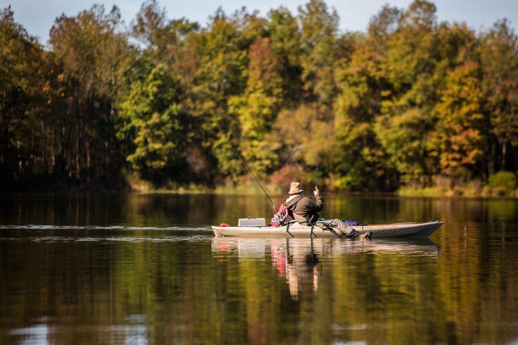 man kayak fishing