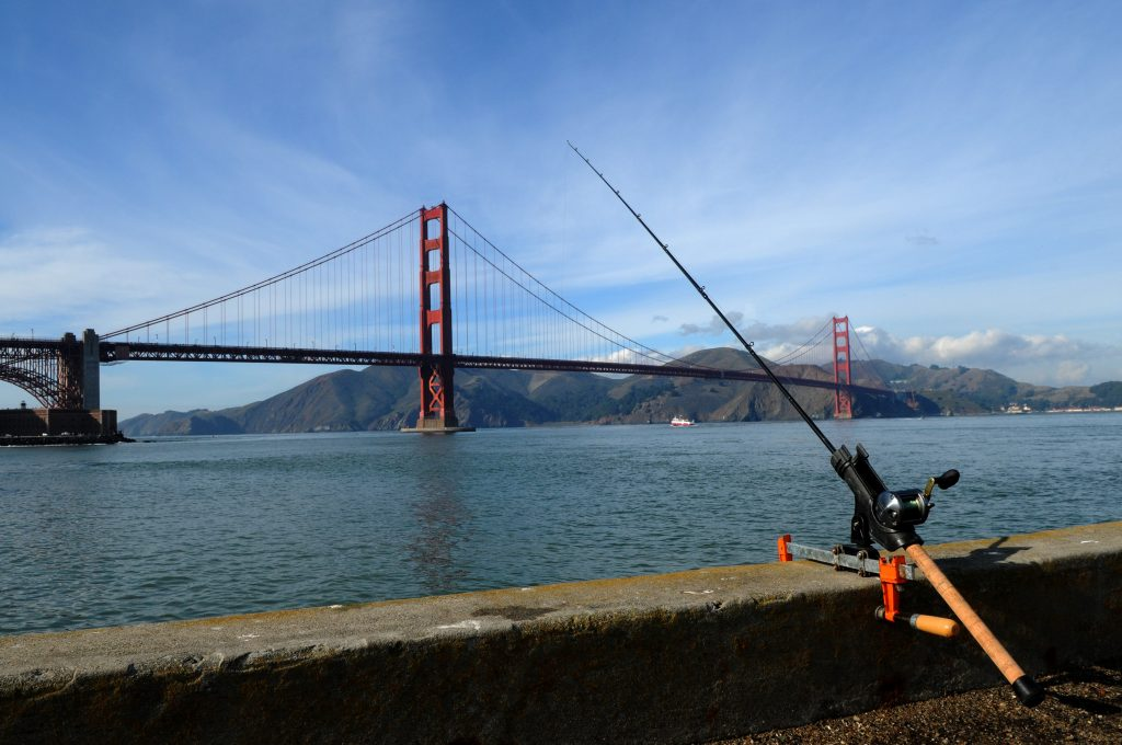 A fishing rod with a view of the San Francisco Bay and the Golden Gate Bridge