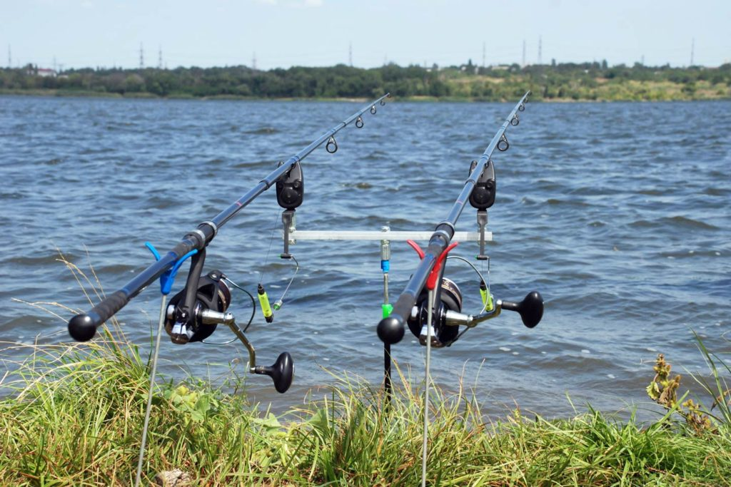Two fishing rods set up on the banks of Louisiana's inshore waters.