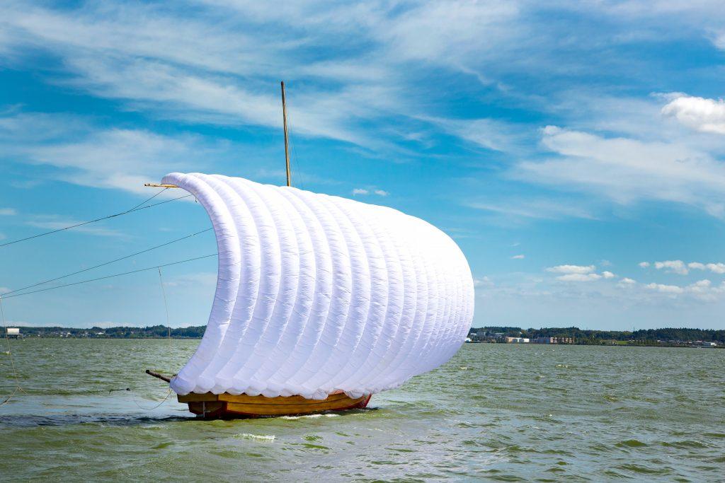 A traditional Japanese hobiki-sen sailing boat cruising on a lake