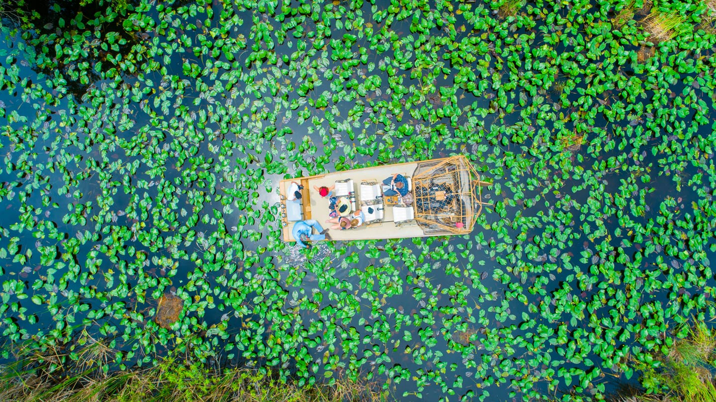 An aerial photo of an airboat in the wetlands of the Everglades, Florida