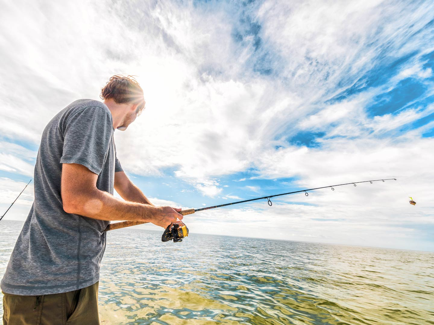 Man holding a rod, fishing in the Everglades, Florida