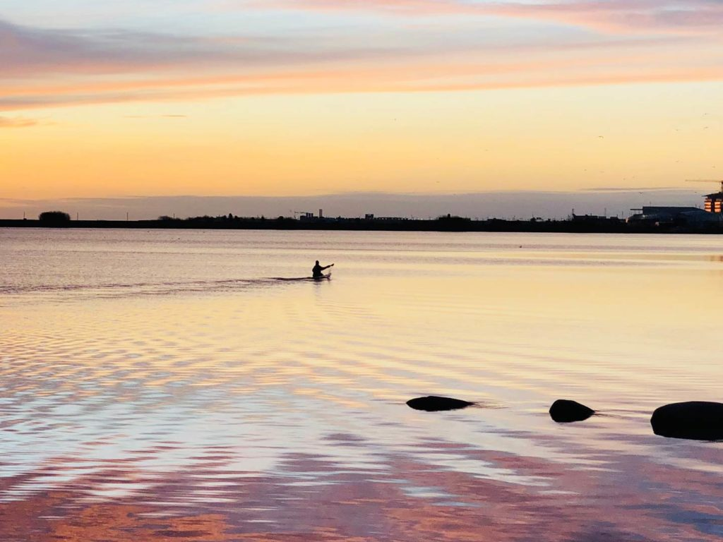An angler kayaking during sunrise out of Copenhagen on the Baltic Sea