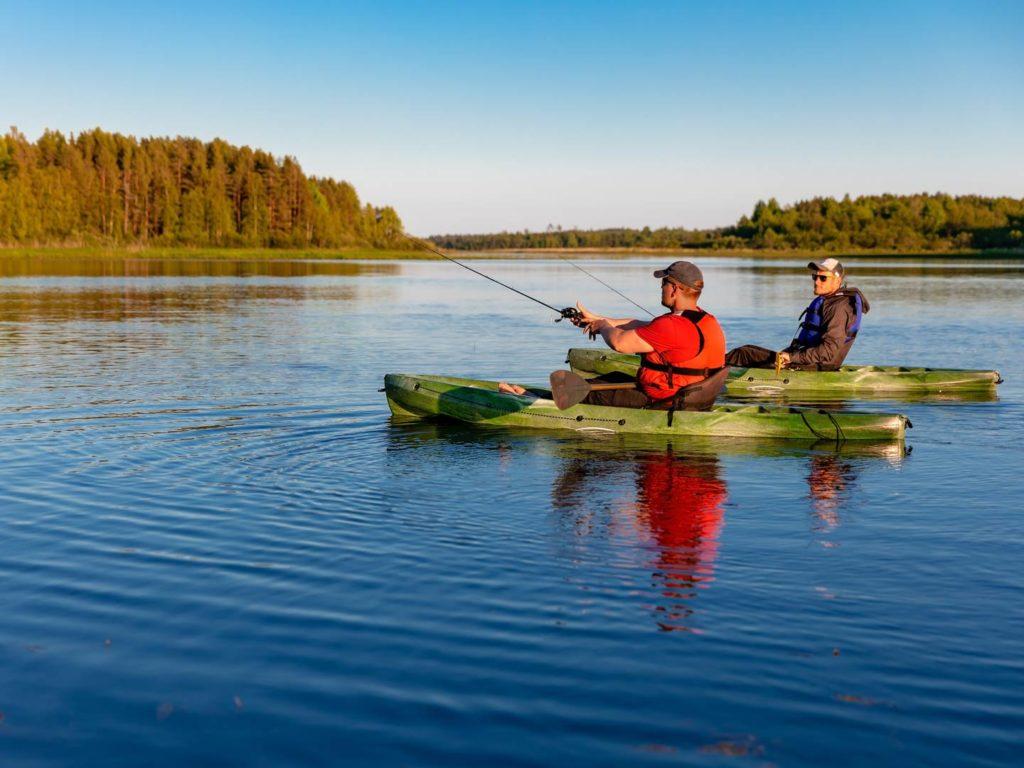 Two men kayak fishing in the Great Lakes