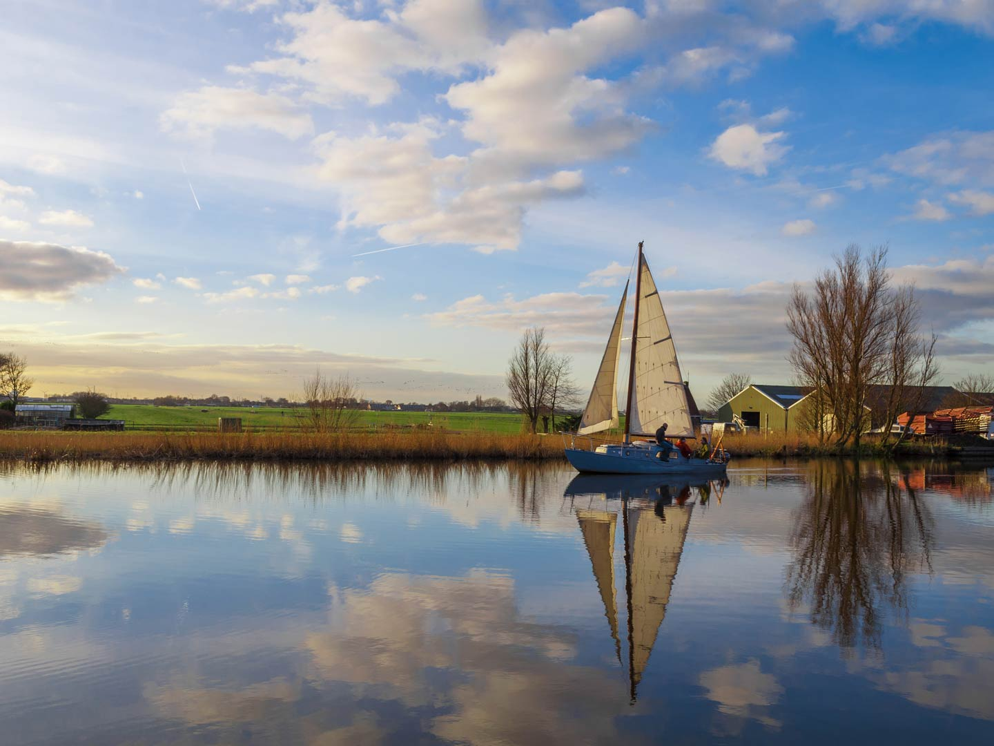 A sailboat on a canal in the Netherlands