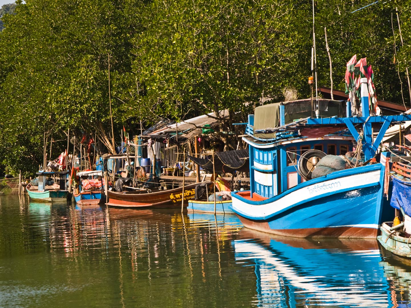 Huts and colorful fishing boats in the mangroves of the Everglades, Florida