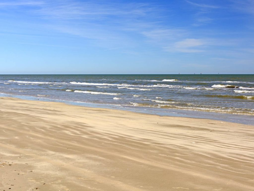 Waves and sand on a remote beach on Padre Island