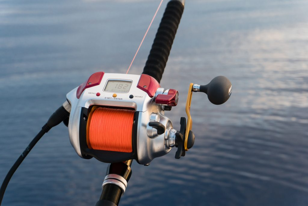 An electric deep dropping fishing reel with red fishing line
