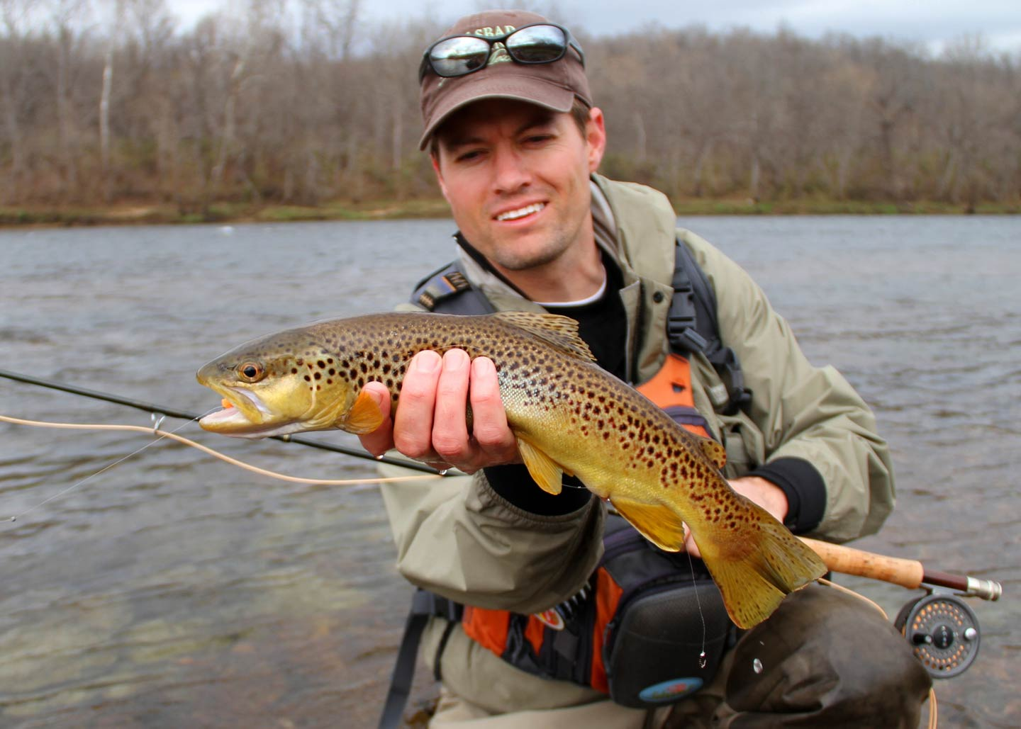 A man holding a Brown Trout in the water