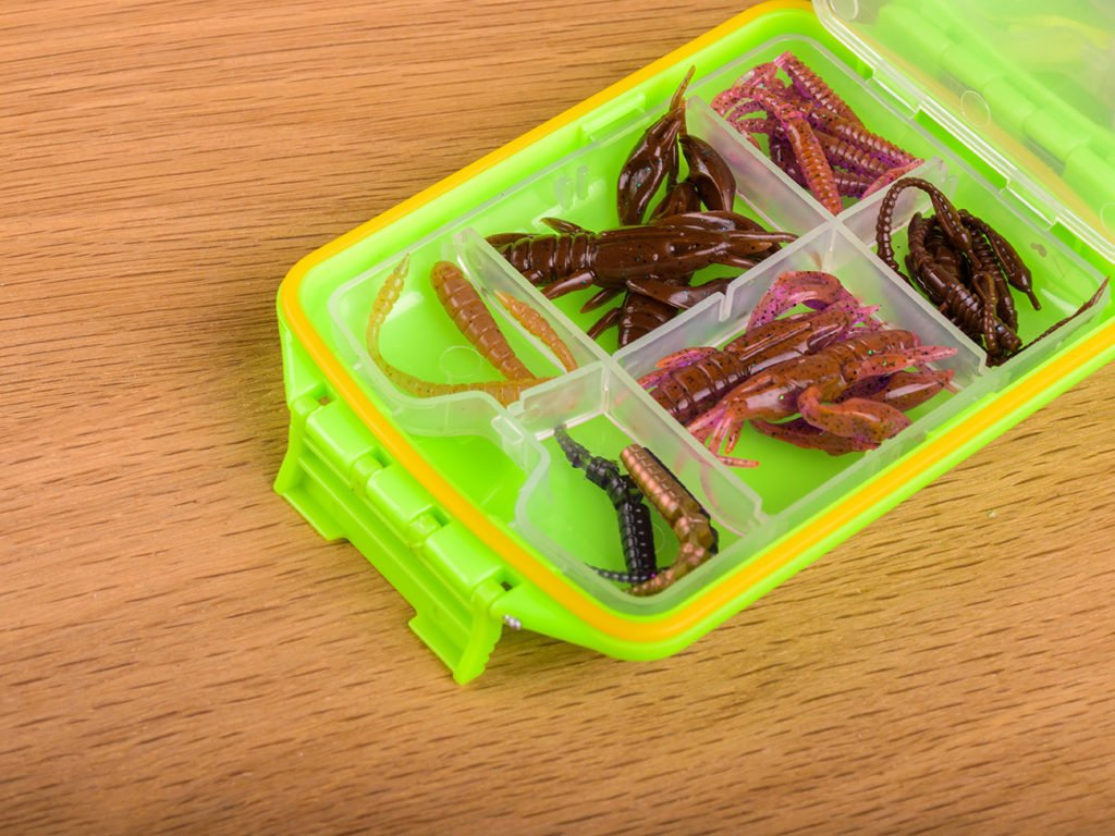A box full of soft plastic worm lures in natural colors
