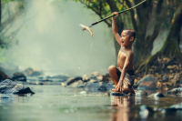 a boy with his spearfishing catch