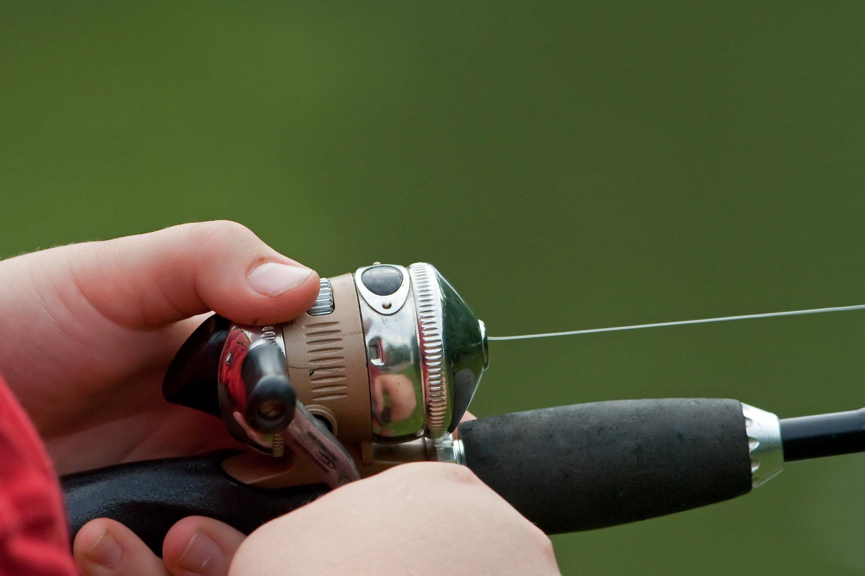 a closeup of a spincast fishing reel