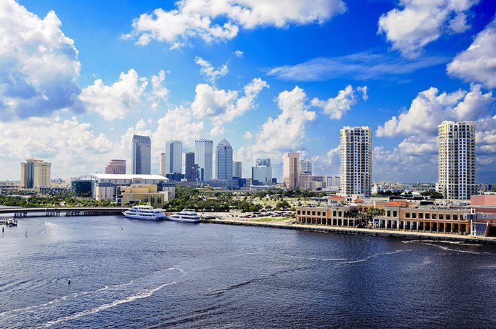 Tampa cityscape with tall buildings looking out onto the Tampa Bay
