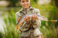 woman holding a fish