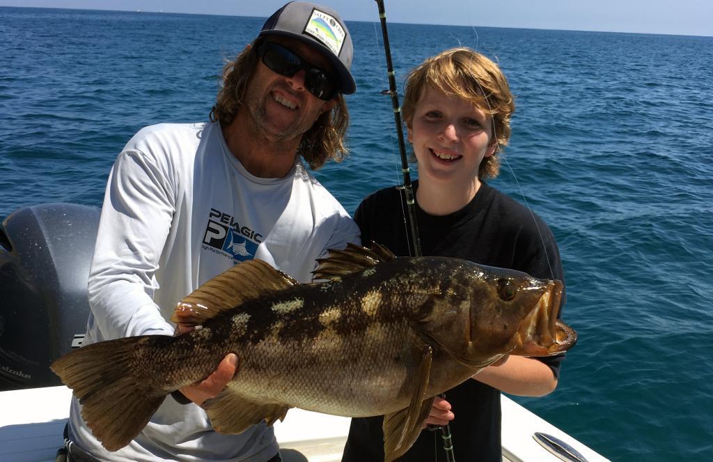 Family fishing trip catching Calico Bass